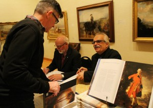 Bernard Riordan, director emeritus (left) and Terry Graff, director and editor-author of Masterworks from the Beaverbrook Art Gallery sign copies at its book launch.