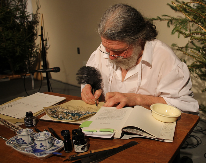 Calligrapher and scribe Fred Harrison (Elgin) uses an ostrich feather pen to copy letters from A Measure of Light.
