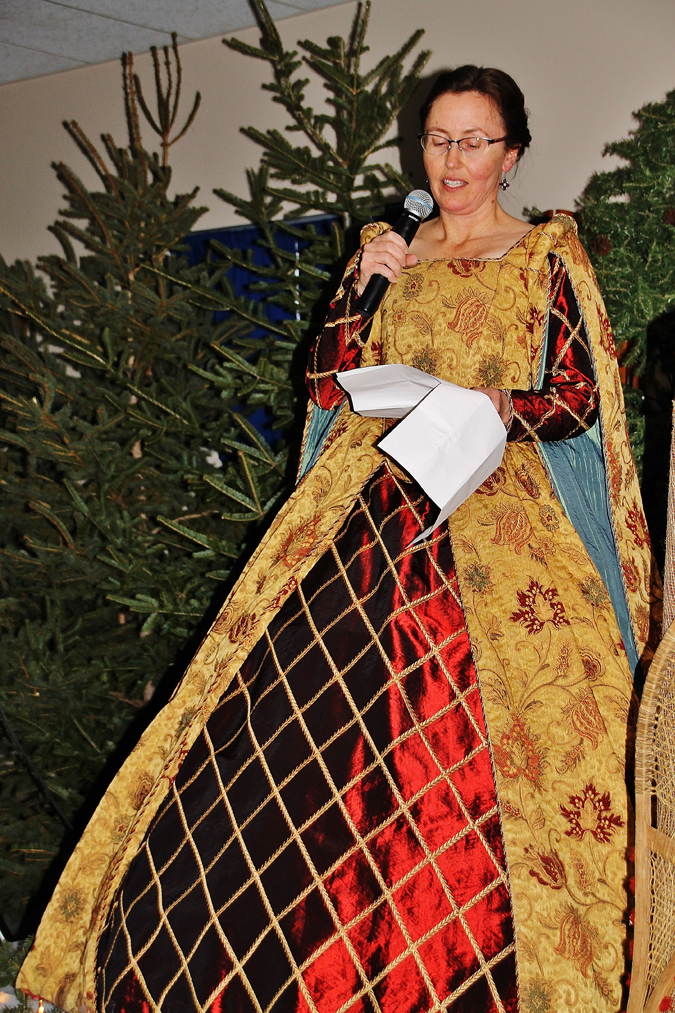 Dr. Sandra Bell of the University of New Brunswick, dressed as a courtier of Charles I, introduced author Beth Powning.