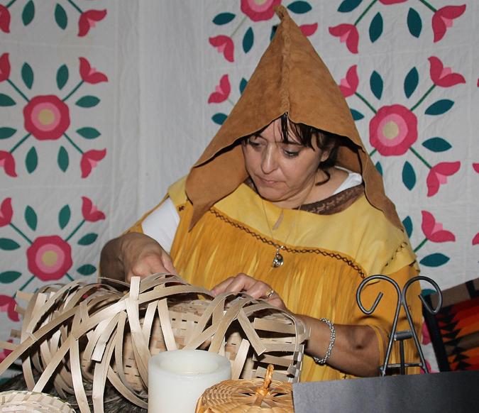 Basket weaver Sandra Racine is an Elder of nearby Elsipogtog First Nation, representing the Narragansett of Massachusetts.