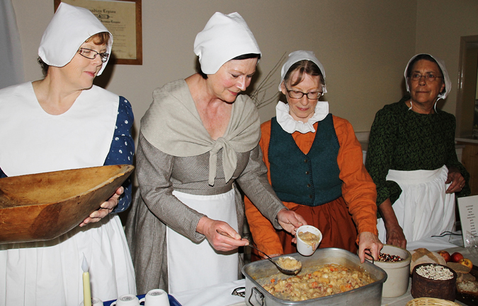 SLICE committee members Deborah Freeze, Cathy Hardy, Jane Achen and Stephanie Coburn served authentic 17th century food – succotash and gnarly bread -- while Picaroons brewery developed 'A Measure of Light Ale'.