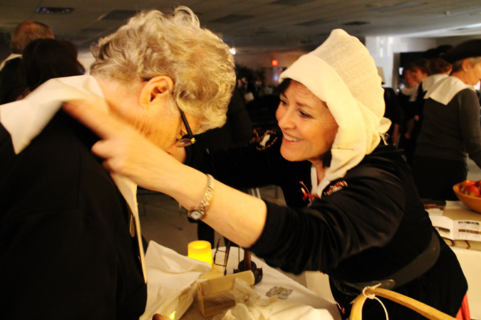 Patricia Stout and SLICE committee members sewed Puritan-style white collars, cuffs, aprons and bonnets for the 500 guests.