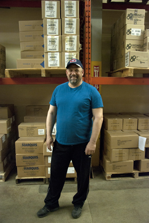 Warehouse manager Kurt Pieper keeps books from various Atlantic Canadian publishers rolling out of the Nimbus warehouse to booksellers across the country. Photo by Joseph Muise