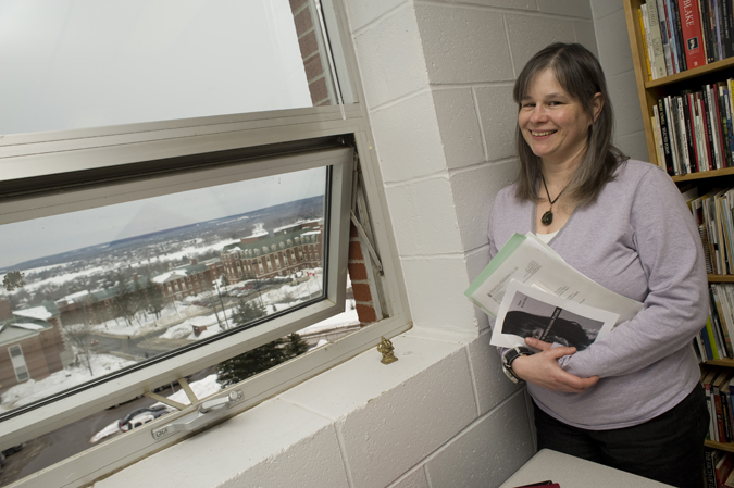 Poet Kathy Mac next to her office window at St. Thomas University. Photo credit: David Smith photo