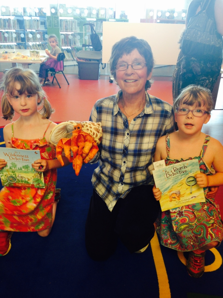 """Author Peggy Kochanoff poses with budding young naturalists at her """"Be a Beach Detective"""" book launch at the Halifax Central Library on Sunday, June 7. Photo courtesy of Nimbus Publishing."""