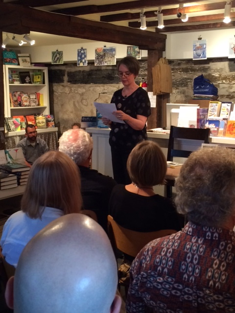 Lexicon Books in Lunnenburg, NS, hosted a, enthusiastic standing-room-only crowd for readings by Binnie Brennan (author of Like Any Other Monday, pictured above), Darren Greer (Just Beneath My Skin), and Charlotte Mendel (A Hero) on July 13. Photo courtesy of Lexicon Books.