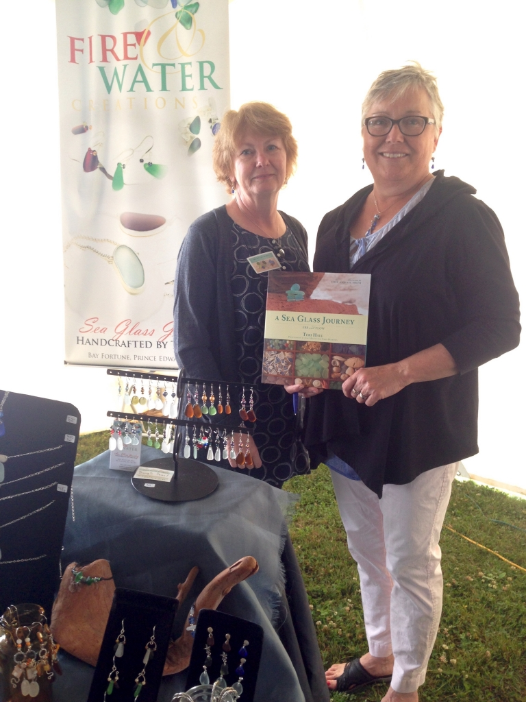 Photographer Jane Milton (L) and author Teri Hall (R) at the 7th annual Sea Glass Festival in Souris, PEI on Saturday, July 25. Photo courtesy of Nimbus Publishing.