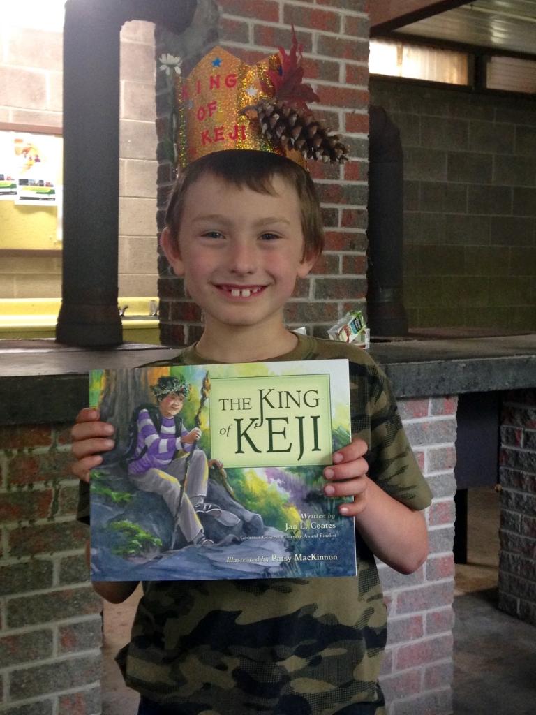 "A young reader at the Kejimkujik book launch of ""The King of Keji"" on Saturday, July 18. Photo courtesy of Nimbus Publishing."