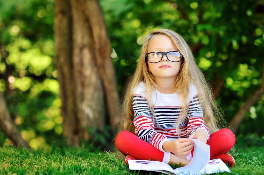 kid glasses reading Atlantic Canadian history