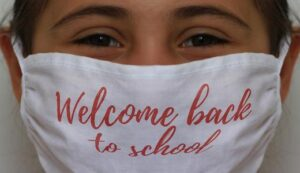 """Photo Of girl wearing mask that says """"welcome back to school"""""""