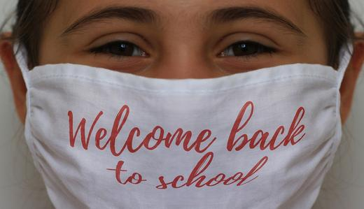"Photo Of girl wearing mask that says ""welcome back to school"""